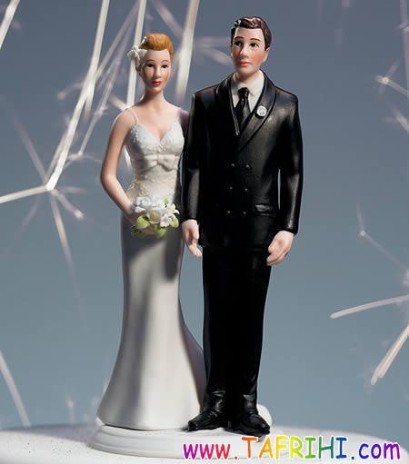 عروسکهای خنده دار بر روی کیکهای عروسی